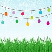 pic of ester  - Easter background with place for text in the sky and  different colors painted Easter Eggs in the green grass - JPG