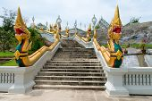 Golden Naga Snakes On Staircases Of Buddhist Temple In Thailand