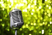 Silver microphone on yellow background
