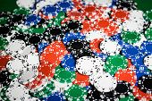 gambling, fortune, game and entertainment concept - close up of casino chips background