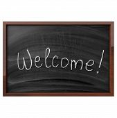 Word Welcome Written On Blackboard
