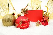 Golden And Red Christmas Decoration On Snow With Wishes Card
