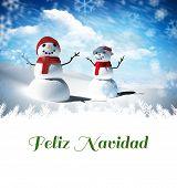 Feliz navidad against snow man family