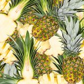 Abstract background with slices of fresh pineapple. Seamless pattern for a design. Close-up. Studio