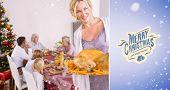 Proud mother showing roast turkey against purple vignette