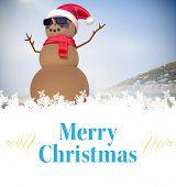 Composite image of christmas card against festive sandman on the beach