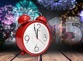 picture of count down  - Alarm clock counting down to twelve against wooden planks background - JPG