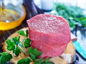 picture of veal meat  - raw meat and parsley on the table - JPG