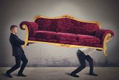 image of heavy  - Men carrying a very heavy antique sofa - JPG