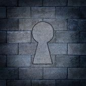 picture of revelation  - Opportunity discovery as a wall made of concrete blocks with one cinder block shaped as a key hole as abusiness symbol or a secure firewall password concept - JPG