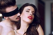 picture of lovers  - Young lover kissing sensual milf neck in luxury hotel desire  - JPG