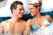 stock photo of tub  - Young couple relaxing in hot tub - JPG