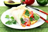 image of glass noodles  - Rice paper stuffed with glass noodles carrots peppers and cilantro - JPG