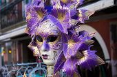 stock photo of venetian carnival  - A traditional handmade venetian carnival purple mask