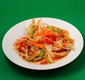 image of green papaya salad  - thai hot papaya salad with a green background - JPG