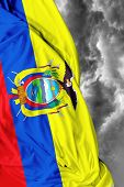 stock photo of guayaquil  - Ecuadorian waving flag on a bad background - JPG