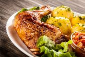 picture of boil  - Barbecued chicken leg with boiled potatoes and vegetables - JPG