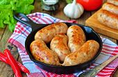 picture of fried chicken  - fried chicken sausages with vegetables on a frying pan - JPG