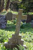 foto of graveyard  - cross on a graveyard on a sunny day - JPG