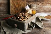 picture of wooden crate  - Dried mushrooms in crate on wooden background - JPG