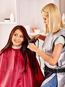 image of hair curlers  - Woman at hairdresser with iron hair curler - JPG