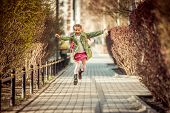 picture of little school girl  - happy little girl running home from school - JPG