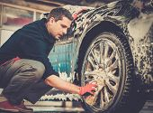 image of alloy  - Man worker washing car - JPG