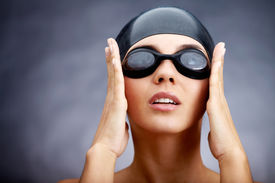 image of athletic woman  - Portrait of a young woman in goggles and swimming cap - JPG