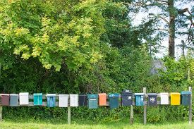 stock photo of mailbox  - Mailboxes in a row at rural cabin site Sweden summertime - JPG