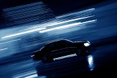 pic of speeding car  - Speeding car at night - JPG