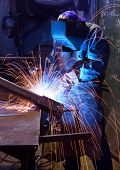 stock photo of welding  - Industrial worker welding in factory - JPG