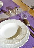Place setting with plate, glass, spoon and knife