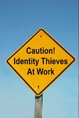 stock photo of cybercrime  - A caution sign warns people to protect their personal information from identity thieves - JPG