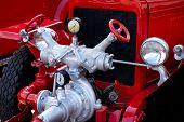 Closeup of antique red fire engine hose cocks and valves