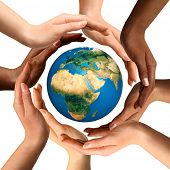 Conceptual symbol of multiracial human hands surrounding the Earth globe. Unity, world peace, humani
