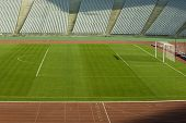 Soccer Field With Green Grass And Running Tracks In A Stadium