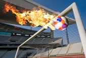 Burning Soccer Ball coming through the goal