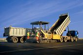 stock photo of spreader  - Asphalt spreader in work - JPG