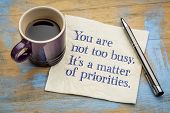 You are not too busy, it is a matter of priorities - handwriting on a napkin with a cup of espresso  poster