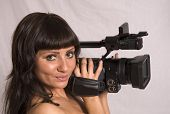pretty girl holding HDV camcorder