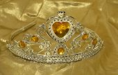 image of beauty pageant  - Photo of a SIlver Tiara on a Gold Background  - JPG