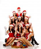 Eight beauty screaming women in Christmas costumes and Santa Claus, isolated on white. may be use for Christmas cards and posters