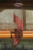 picture of windchime  - bamboo wind chimes hanging from roof in garden - JPG