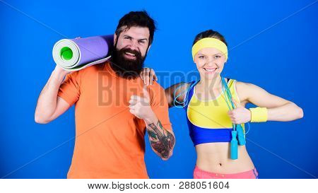 poster of Healthy Lifestyle Concept. Man And Woman Exercising With Yoga Mat And Jump Rope. Fitness Exercises.