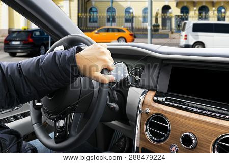 poster of Male Hands Holding Car Steering Wheel. Hands On Steering Wheel Of A Car Driving. Young Man Driving A