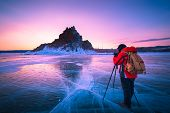 Photographer Or Traveller Using A Professional Dslr Camera Take Photo Beautiful Landscape Of Baikal  poster