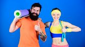 Healthy Lifestyle Concept. Man And Woman Exercising With Yoga Mat And Jump Rope. Fitness Exercises.  poster