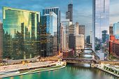 Chicago, Illinois USA skyline over the river at twilight. poster