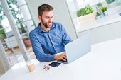 Handsome business man working using computer laptop and smiling poster