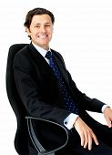 Clean shaven businessman sitting in an office chair